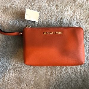 Micheal Kors Wristlet -- Brown & Tangerine colored